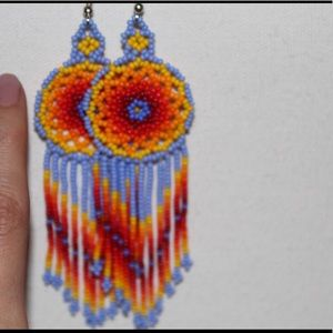 Earrings. Cool lavender and warm orange hues.